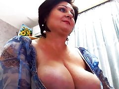 Super busty Dina Brandy, a milf with huge tits on cam