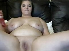 BBW girl with long dildo fucks pussy and rubs tits