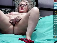 Russian woman takes off her clothes and jerks off her pussy